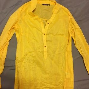 Bright yellow tunic or Kurti.